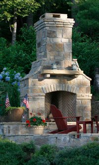 concrete fireplace in a backyard